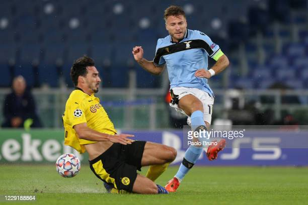 Mats Hummeles of Borussia Dortmund competes for the ball with Ciro Immobile of SS Lazio during the UEFA Champions League Group F stage match between...