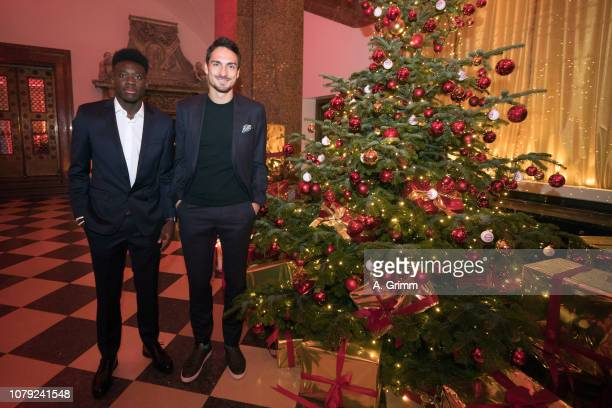 Mats Hummels and Alphonso Davies arrive for the FC Bayern Muenchen Christmas Party at Palais Lenbach on December 08 2018 in Munich Germany