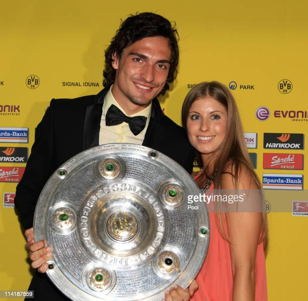 Mats Hummels and his girlfriend Catherine Fischer pose with the German Championship trophy during the dinner to celebrate their German Bundesliga...