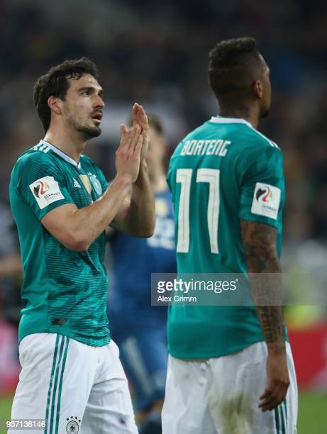 Mats Hummels and Jerome Boateng of Germany react after the international friendly match between Germany and Spain at EspritArena on March 23 2018 in...