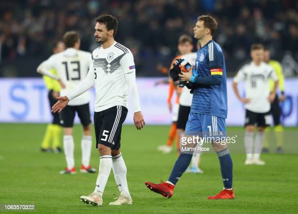 Mats Hummels and Manuel Neuer of Germany look dejected following their draw in the UEFA Nations League A group one match between Germany and...