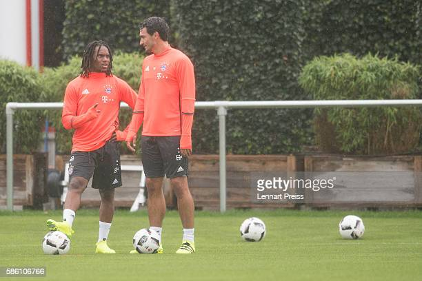 Mats Hummels and Renato Sanches talk to each other during a training session of FC Bayern Muenchen on August 5 2016 in Munich Germany
