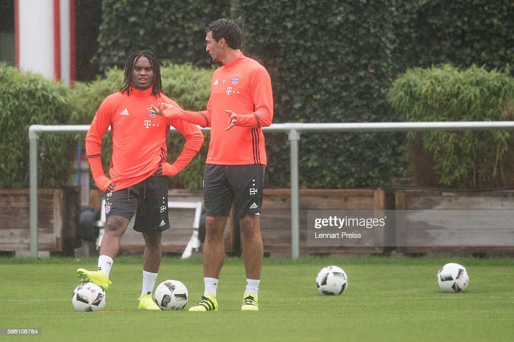 Mats Hummels (R) and Renato Sanches talk to each other during a training session of FC Bayern Muenchen on August 5, 2016 in Munich, Germany.