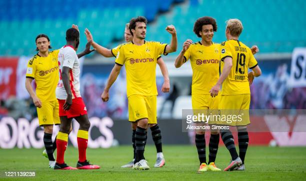 Mats Hummels Axel Witsel and Julian Brandt of Borussia Dortmund are celebrating the win after the final whistle during the Bundesliga match between...