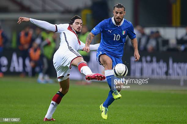 Mats Hummels challenges Daniel Pablo Osvaldo of Italy during the International Friendly match between Italy and Germany at San Siro Stadium on...