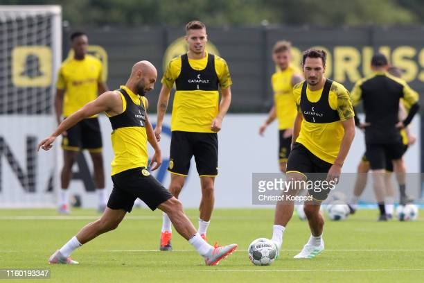 Mats Hummels challenges Omer Toprak during a Borussia Dortmund training session at Training Ground Brackel on July 05 2019 in Dortmund Germany The...