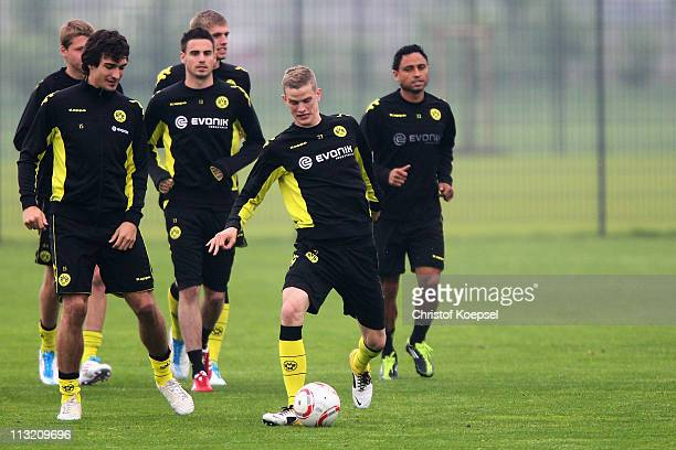 Mats Hummels Damien le Tallec Lukasz Piszczek and Antonio da Silva run during a Borussia Dortmund training session at the Dortmund Brackel training...