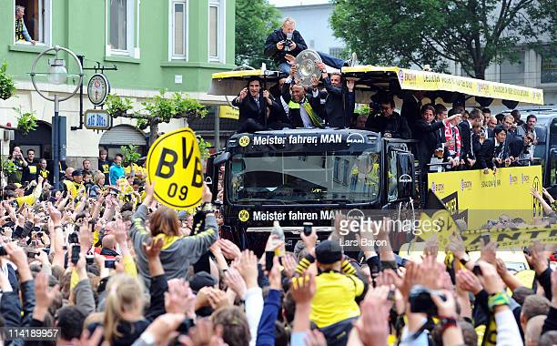 Mats Hummels Dede and Mario Goetze lift the trophy and celebrate winning the German championship with team mates and fans during the Borussia...