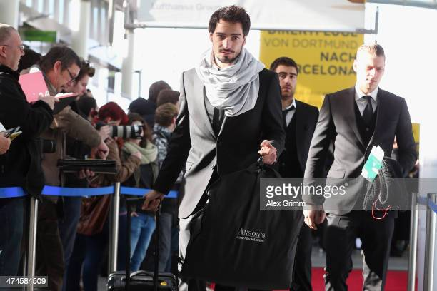 Mats Hummels departs with Borussia Dortmund for the team's UEFA Champions League Round of 16 match against Saint Petersburg at the airport on...
