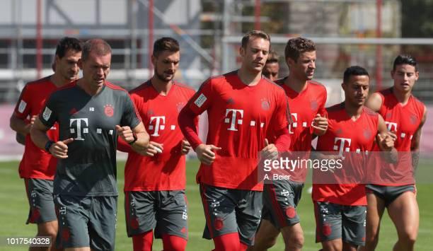 Mats Hummels, fitness coach Holger Broich, goalkeeper Sven Ulreich, goalkeeper Manuel Neuer, Thomas Mueller, Thiago and James Rodriguez of FC Bayern...