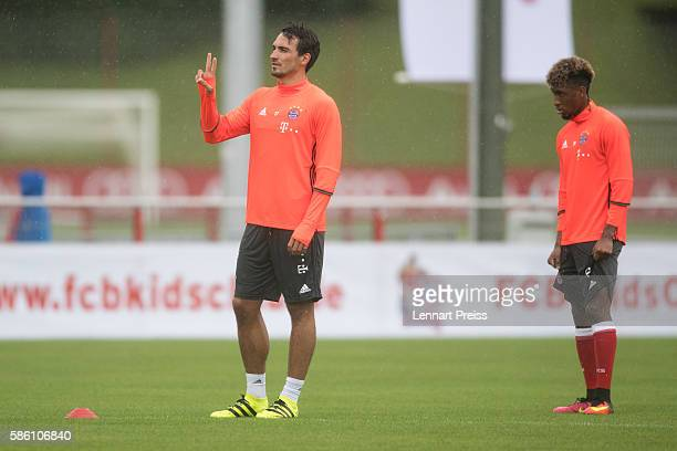 Mats Hummels gestures next to Kingsley Coman during a training session of FC Bayern Muenchen on August 5 2016 in Munich Germany