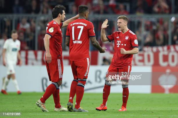 Mats Hummels, Jerome Boateng and Joshua Kimmich of Muenchen celebrate after the DFB Cup quarterfinal match between Bayern Muenchen and 1. FC...