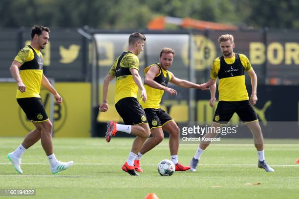Mats Hummels Julian Weigl Mario Goetze and Marcel Schmelzer kick during a Borussia Dortmund training session at Training Ground Brackel on July 05...