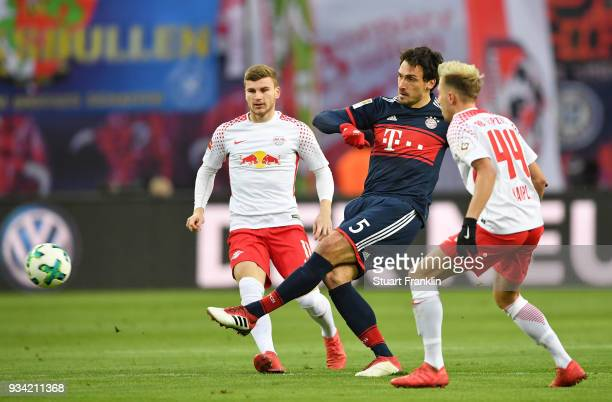 Mats Hummels of Bayern is challenged by Kevin Kampl of Leipzig during the Bundesliga match between RB Leipzig and FC Bayern Muenchen at Red Bull...