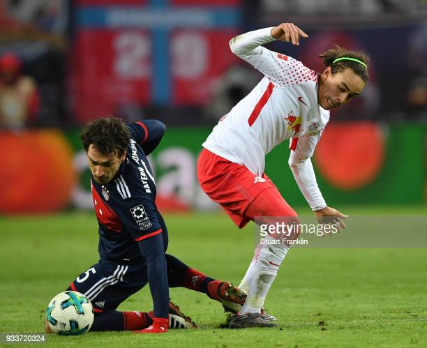 Mats Hummels of Bayern is challenged by Yussuf Poulsen of Leipzig during the Bundesliga match between RB Leipzig and FC Bayern Muenchen at Red Bull...