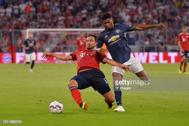 Mats Hummels of Bayern Muenchen and Marcus Rashford of Manchester United battle for the ball during the friendly match between Bayern Muenchen and...