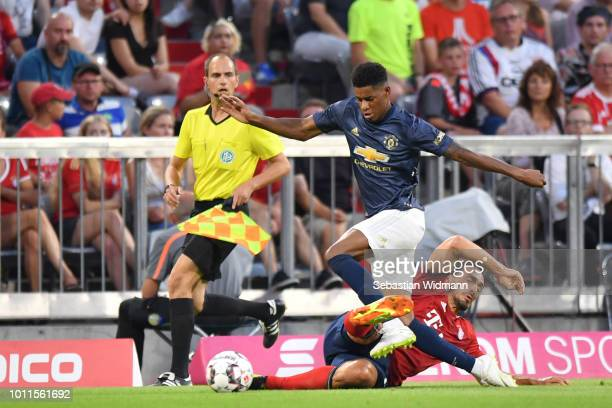 Mats Hummels of Bayern Muenchen challenges Marcus Rashford of Manchester for the ball during the friendly match between Bayern Muenchen and...