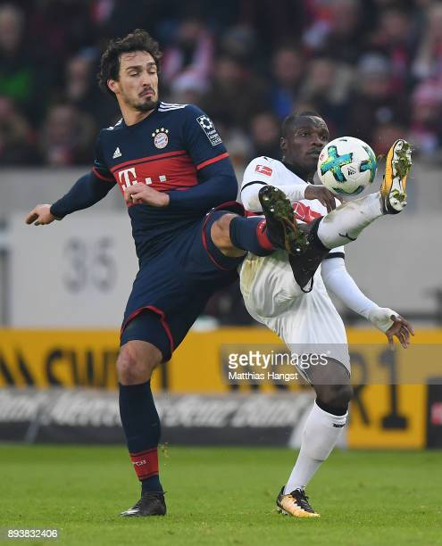 Mats Hummels of Bayern Muenchen fights for the ball with Chadrac Akolo of Stuttgart during the Bundesliga match between VfB Stuttgart and FC Bayern...