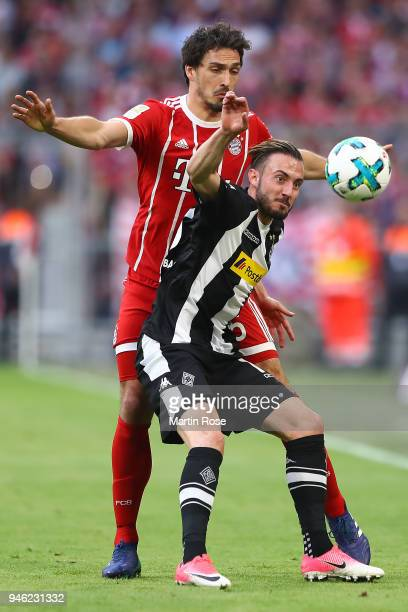 Mats Hummels of Bayern Muenchen fights for the ball with Josip Drmic of Moenchengladbach during the Bundesliga match between FC Bayern Muenchen and...