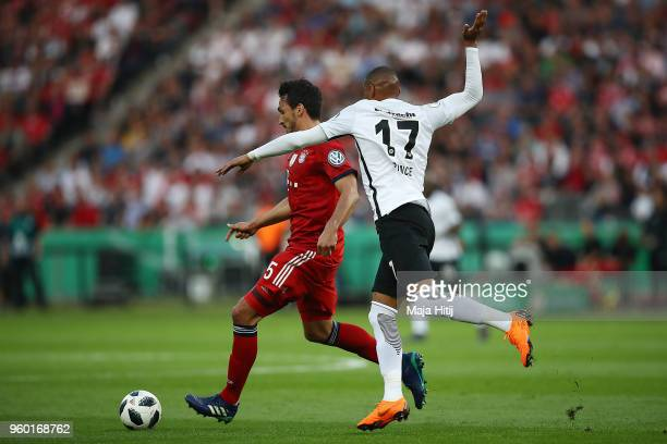 Mats Hummels of Bayern Muenchen fights for the ball with Kevin PrinceBoateng of Frankfurtduring the DFB Cup final between Bayern Muenchen and...