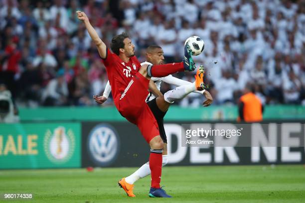 Mats Hummels of Bayern Muenchen fights for the ball with Kevin PrinceBoateng of Frankfurt during the DFB Cup final between Bayern Muenchen and...