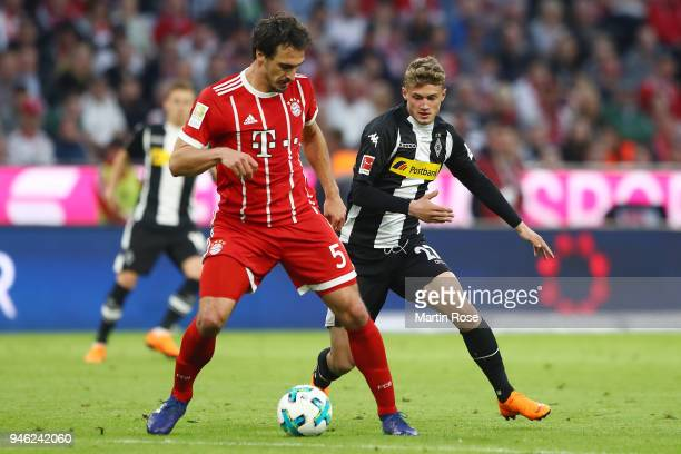 Mats Hummels of Bayern Muenchen fights for the ball with Michael Cuisance of Moenchengladbach during the Bundesliga match between FC Bayern Muenchen...