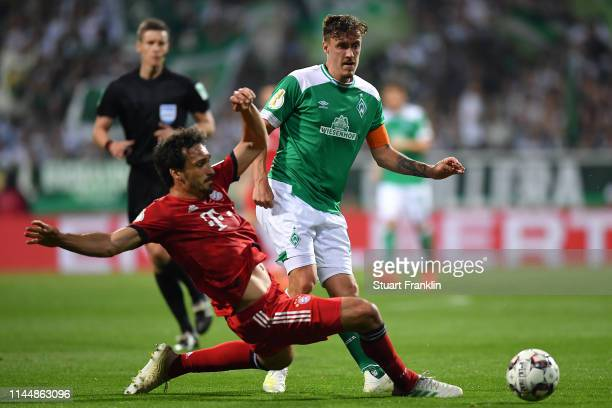 Mats Hummels of Bayern Munich and Max Kruse of Werder Bremen battle for possession during the DFB Cup semi final match between Werder Bremen and FC...