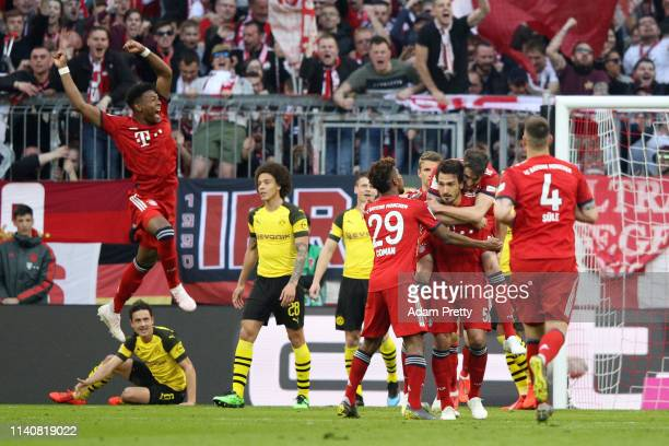 Mats Hummels of Bayern Munich celebrates after scoring his team's first goal with his team mates during the Bundesliga match between FC Bayern...