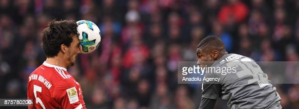 Mats Hummels of Bayern Munich in action against Kevin Danso of Augsburg during the Bundesliga soccer match between FC Bayern Munich and FC Augsburg...