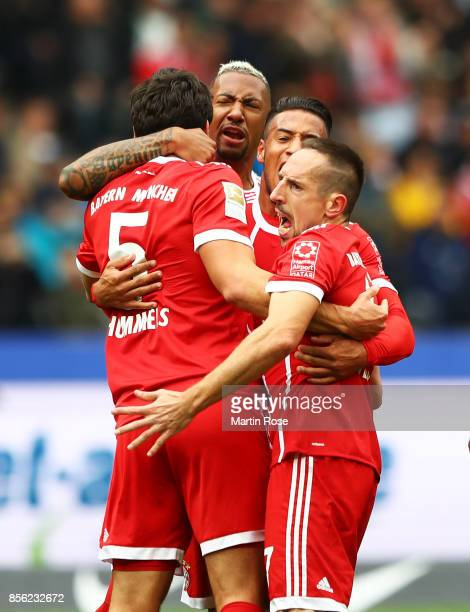 Mats Hummels of Bayern Munich is congratulated after socring a goal during the Bundesliga match between Hertha BSC and FC Bayern Muenchen at...