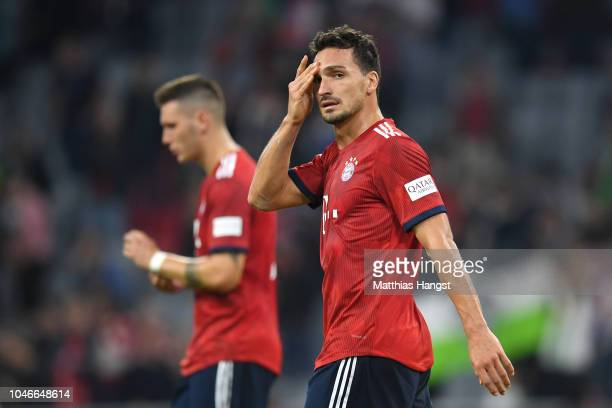Mats Hummels of Bayern Munich looks dejected following his sides defeat in the Bundesliga match between FC Bayern Muenchen and Borussia...