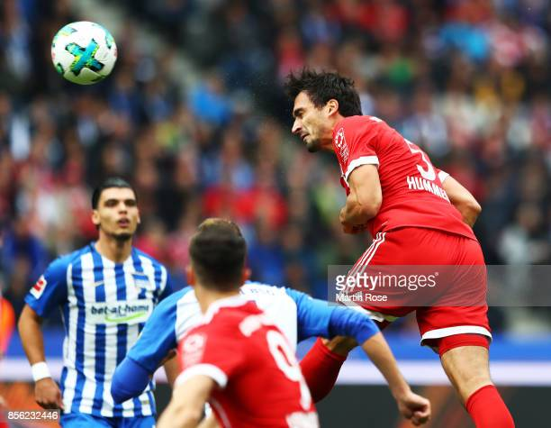 Mats Hummels of Bayern Munich scores a goal during the Bundesliga match between Hertha BSC and FC Bayern Muenchen at Olympiastadion on October 1 2017...