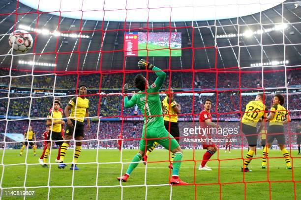 Mats Hummels of Bayern Munich scores his team's first goal past Roman Buerki of Borussia Dortmund during the Bundesliga match between FC Bayern...