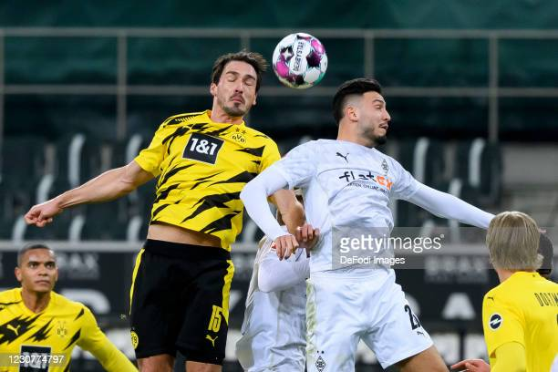 Mats Hummels of Borussia Dortmund and Ramy Bensebaini of Borussia Moenchengladbach battle for the ball during the Bundesliga match between Borussia...