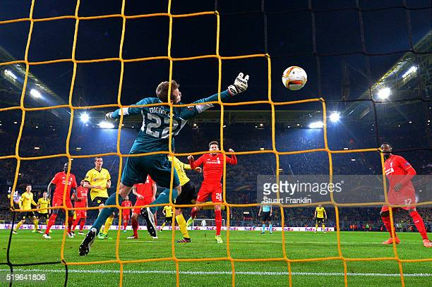 Mats Hummels of Borussia Dortmund beats goalkeeper Simon Mignolet of Liverpool to score their first goal during the UEFA Europa League quarter final...