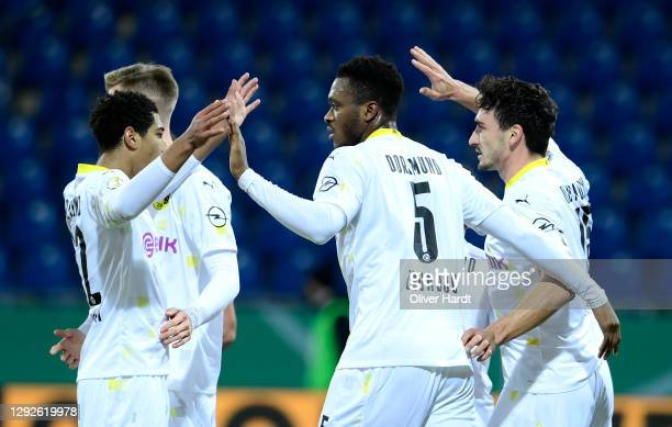 Mats Hummels of Borussia Dortmund celebrates after scoring their sides first goal with Dan-Axel Zagadou and Jude Bellingham of Borussia Dortmund...