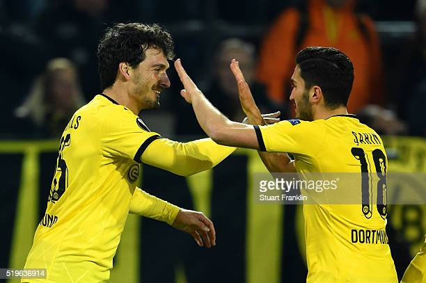Mats Hummels of Borussia Dortmund celebrates with Nuri Sahin as he scores their first goal during the UEFA Europa League quarter final first leg...