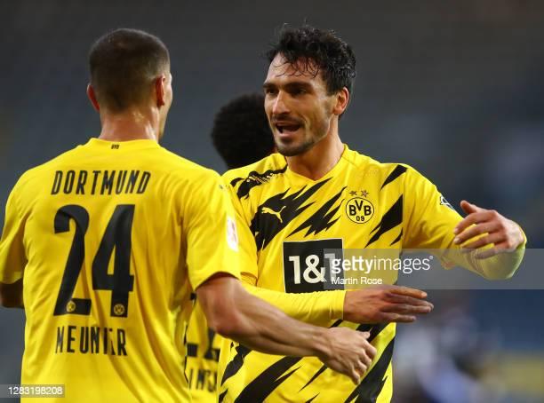 Mats Hummels of Borussia Dortmund celebrates with teammate Thomas Meunier after scoring his team's second goal during the Bundesliga match between...