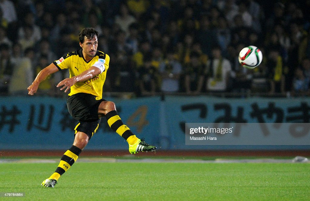 Mats Hummels #15 of Borussia Dortmund in action in flont of Japanese (Kanji and Hiragana on bunner.Name of Kawasaki Frontale players.) during the preseason friendly match between Kawasaki Frontale and Borussia Dortmund at Todoroki Stadium on July 7, 2015 in Kawasaki, Kanagawa, Japan.