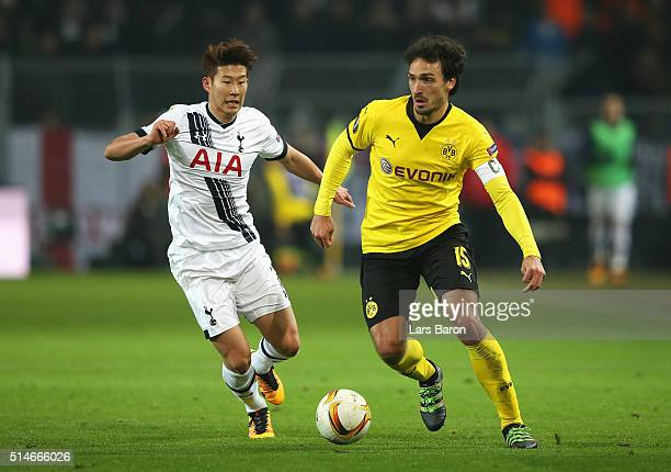 Mats Hummels of Borussia Dortmund is chased by Son Heungmin of Tottenham Hotspur during the UEFA Europa League Round of 16 first leg match between...