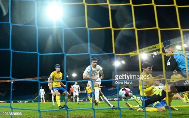 Mats Hummels of Borussia Dortmund scores their sides first goal during the DFB Cup second round match between Eintracht Braunschweig and Borussia...