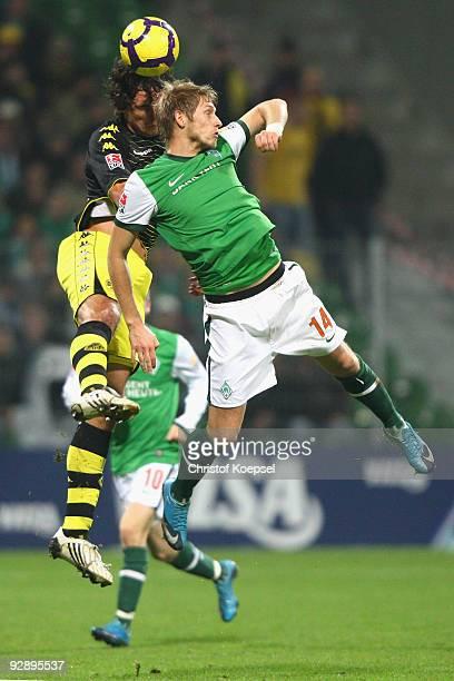 Mats Hummels of Dortmund and Aaron Hunt of Bremen go up for a header during the Bundesliga match between SV Werder Bremen and Borussia Dortmund at...
