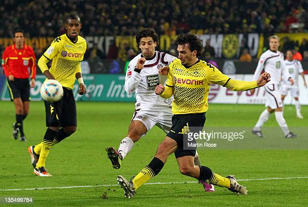 Mats Hummels of Dortmund and Olcay Sahan of Kaiserslautern battle for the ball during the Bundesliga match between Borussia Dortmund and 1. FC...