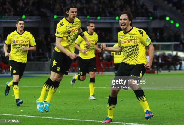 Mats Hummels of Dortmund celebrates after scoring his team's second goal during the DFB Cup final match between Borussia Dortmund and FC Bayern...