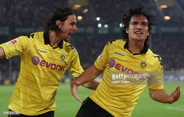Mats Hummels of Dortmund celebrates with his team mate Neven Subotic after scoring his team's third goal during the Bundesliga match between Borussia...