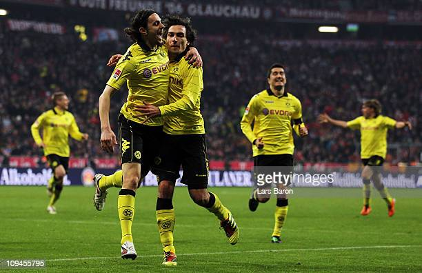 Mats Hummels of Dortmund celebrates with Neven Subotic after scoring his teams third goal during the Bundesliga match between FC Bayern Muenchen and...