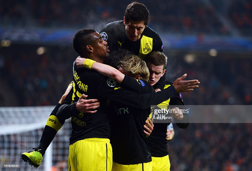 Mats Hummels of Dortmund celebrates with Robert Lewandowski and other team mates after scoring his teams second goal during the UEFA Champions League Round of 16 first leg match between Shakhtar Donetsk and Borussia Dortmund at Donbass Arena on February 13, 2013 in Donetsk, Ukraine.