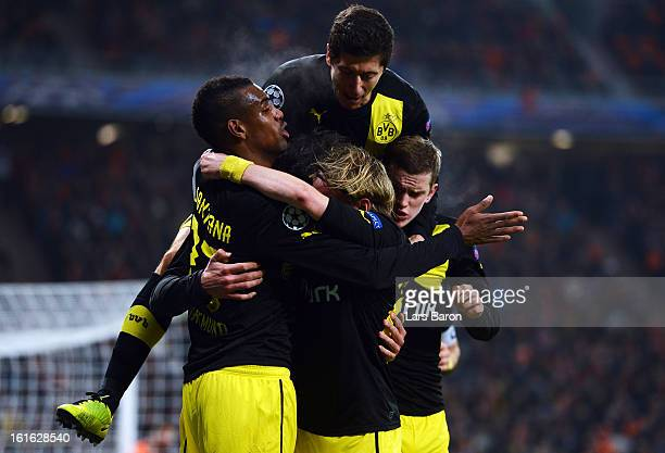 Mats Hummels of Dortmund celebrates with Robert Lewandowski and other team mates after scoring his teams second goal during the UEFA Champions League...
