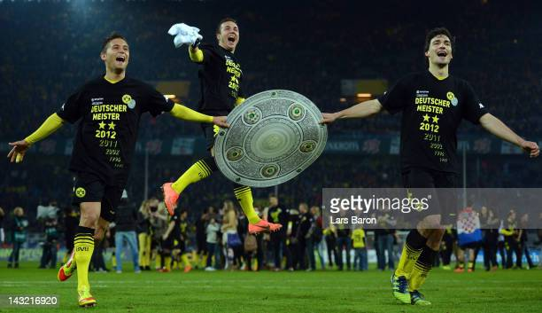 Mats Hummels of Dortmund celebrates with team mates Moritz Leitner and MArio Goetze after winning the Bundesliga match between Borussia Dortmund and...