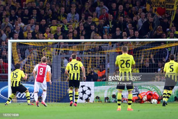Mats Hummels of Dortmund fails scoring a penalty against Kenneth Vermeer of Amsterdam during the UEFA Champions League group D match between Borussia...